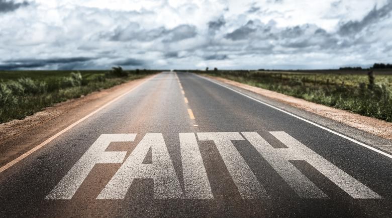 "A street with the word ""faith""written on it"