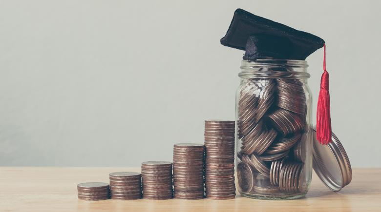 Stacks of coins with a graduation cap
