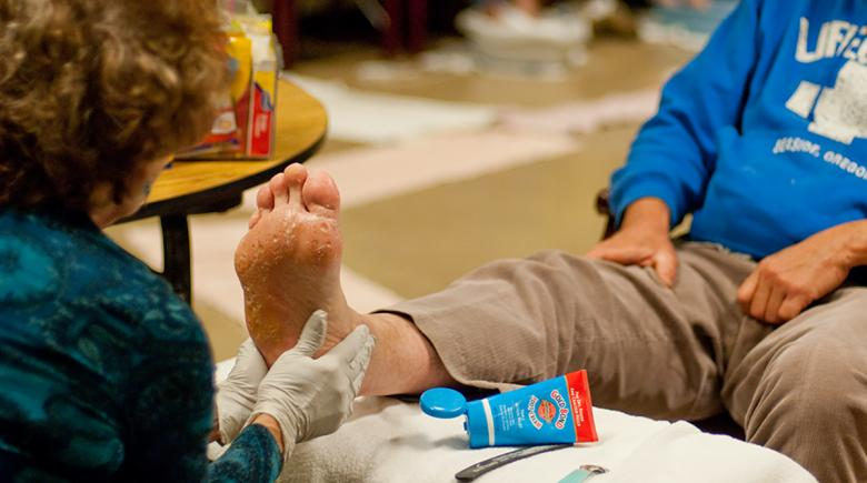 A health care provider helps someone with foot relief