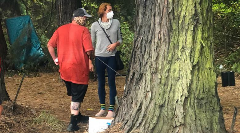 Street Roots ambassadors Mike Dusek and Raven Drake dispatched to Forest Park last September to warn people of fire dangers. Ambassadors are preparing to resume this work in a larger coordinated effort with Portland Fire & Rescue.