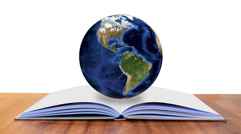 Photo illustration of a globe and a book
