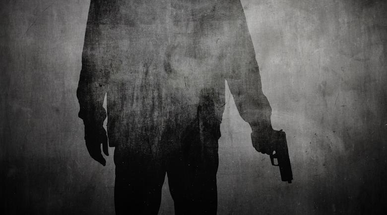 Illustration depicts a shadow of a person holding a gun