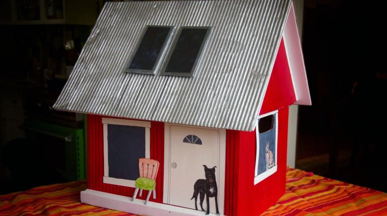 A red tiny house that contained the petition to save Hazelnut Grove