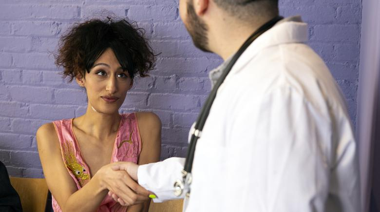 A woman meets with her doctor