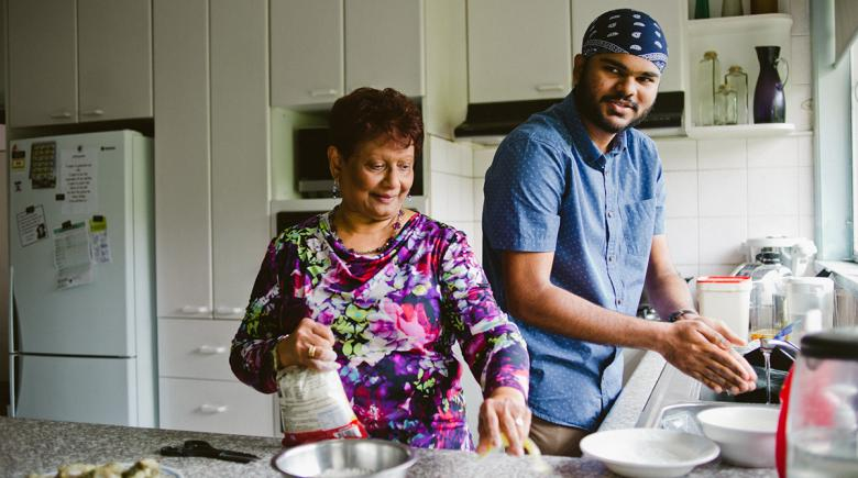 Philomena cooks in the kitchen with Rakesh