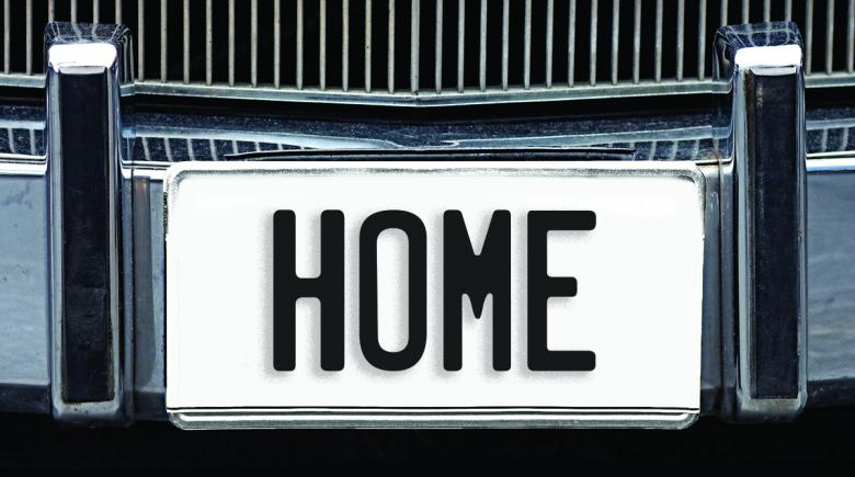 Car license plate that reads: HOME
