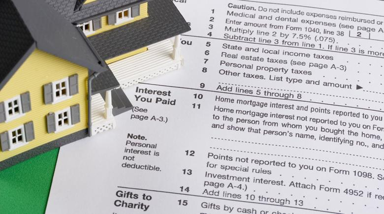 Illustration of a house along with tax returns