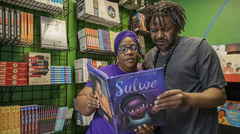 Charles Hannah and Michelle Lewis look at a book at Third Eye Books
