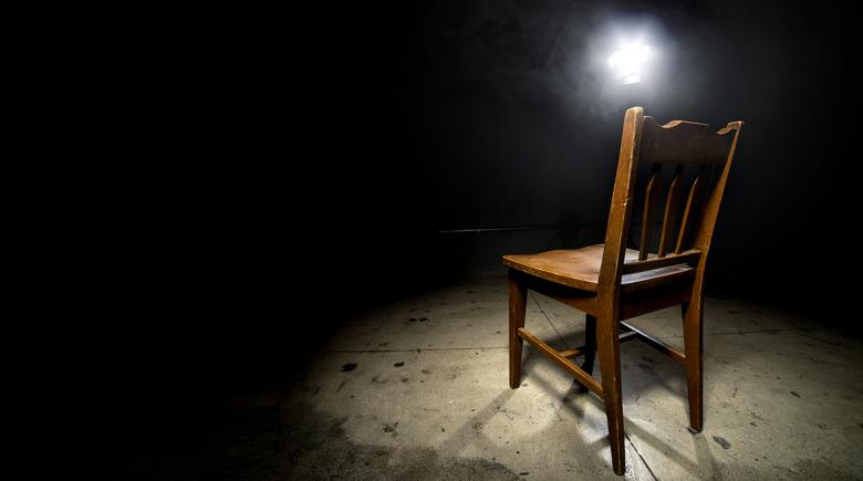 Spotlight shining on an empty chair