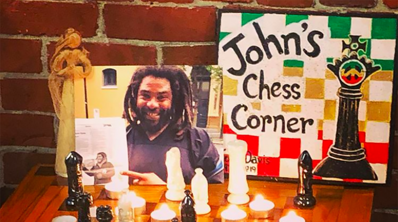 A chess board is set up to honor John Davis