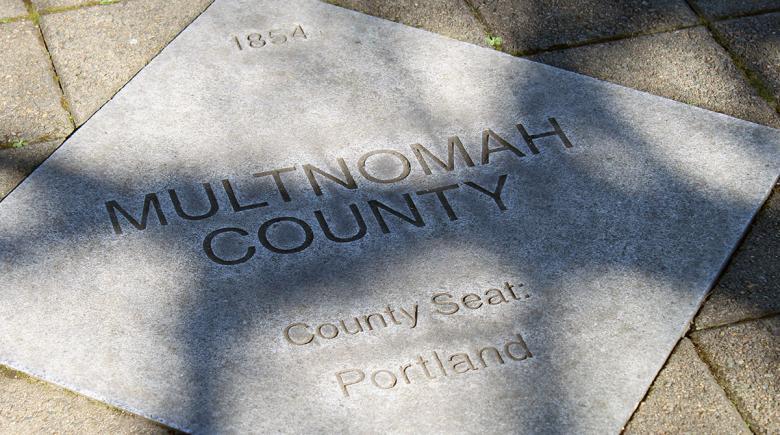 Multnomah County sidewalk imprint