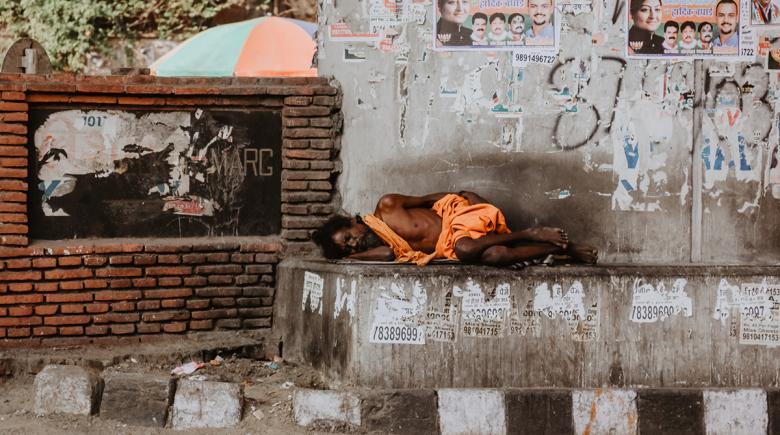 Homeless person sleeps outdoors