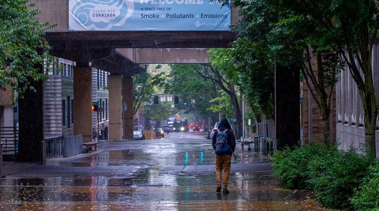 A student walks through Portland State University campus.