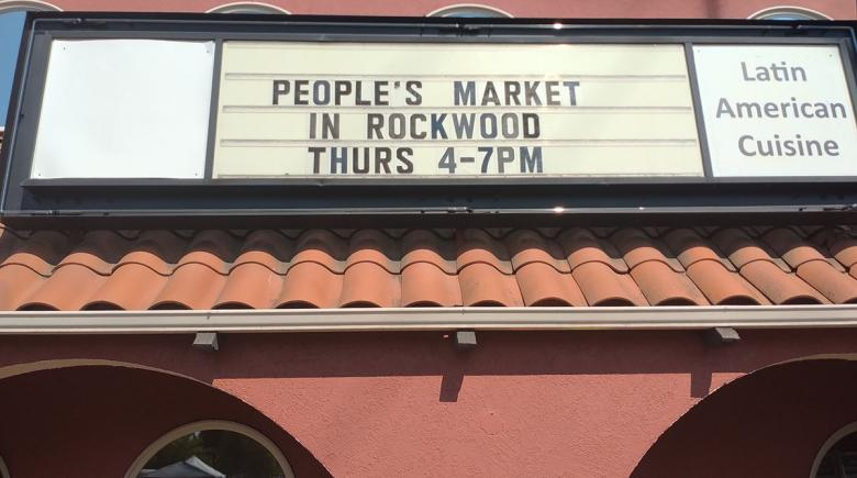 """Photo of a marquee reading """"People's market in Rockwood. Thurs. 4-7PM"""""""