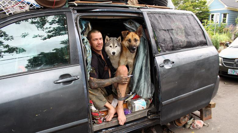 Joshua Peters in his van with his dogs