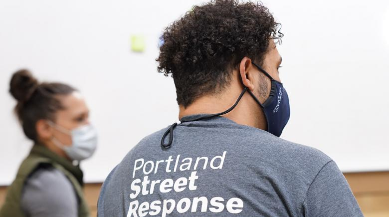 Tremaine Clayton wears a Portland Street Response T-shirt and a protective face mask