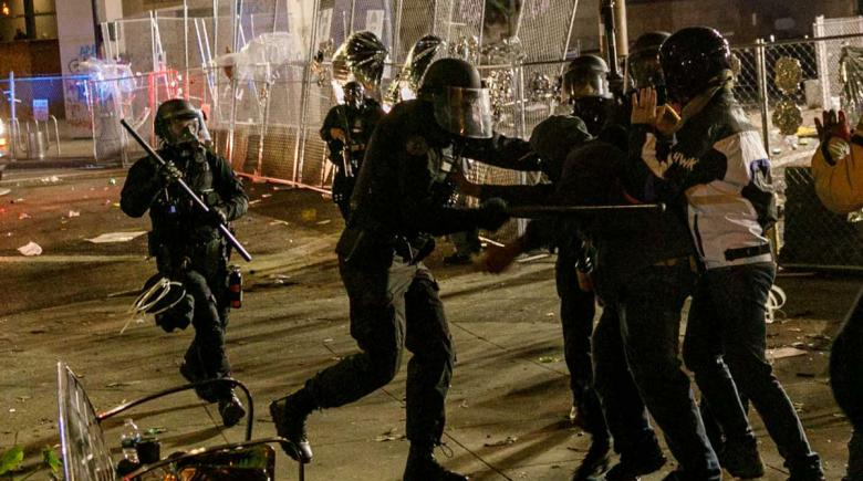 Police in riot gear clash with protesters