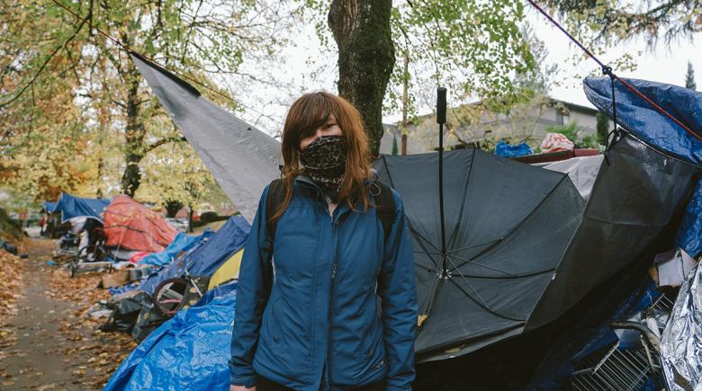 Portrait of Aarika in front of her camp