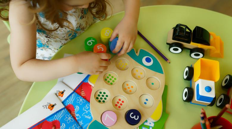 Child using preschool learning toys