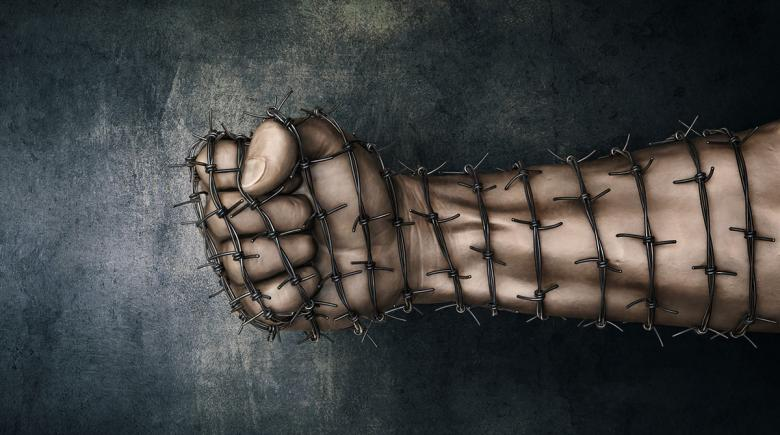 Illustration of an arm and fist covered in barbed wire