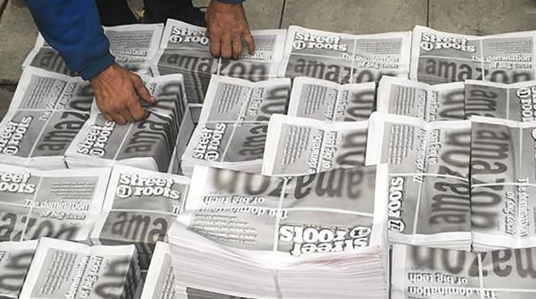 Street Roots newspaper bundles
