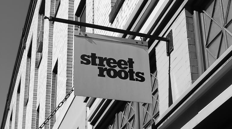 Sign in front of the Street Roots office
