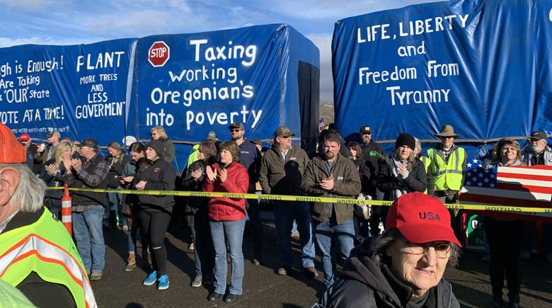 Signs on large trucks protest taxes and government control