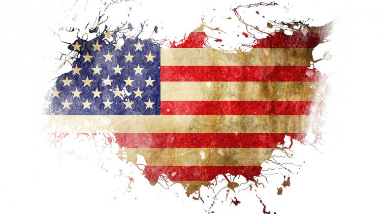 American flag, in the shape of the United States, in tatters