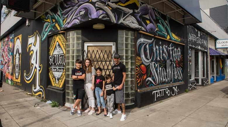 Nisha Supahan, Toby Linwood and their family outside Tattoo 34