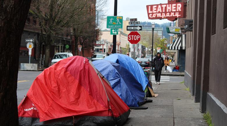 Tents on a sidewalk in Old Town
