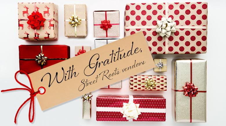 Wrapped gifts with a tag that reads: With Gratitude, Street Roots vendors