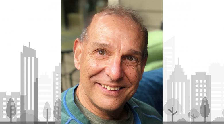 Bobby Weinstock photo in front of an illustration of a city skyline.