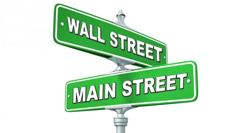 Street signs showing intersection of Wall Street and Main Street