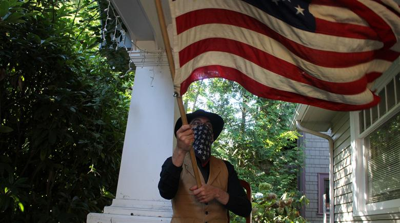 Xander Almeida with an American flag