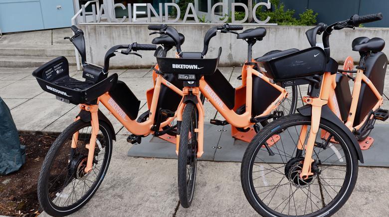 Biketown e-bikes parked outside of Hacienda CDC