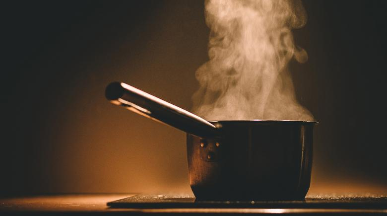 A steaming pot on a stove