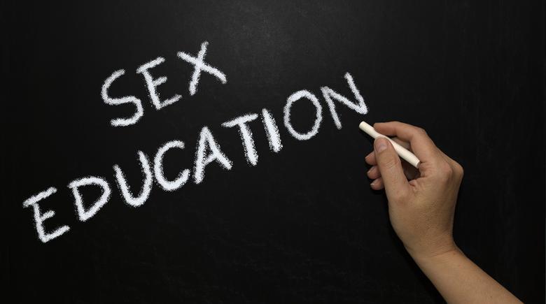 """""""Sex education"""" is written on a blackboard"""