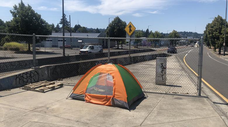 Orange tent on a city sidewalk