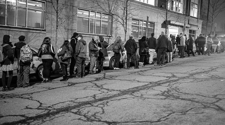St. Francis applicants line up outside Catholic Charities