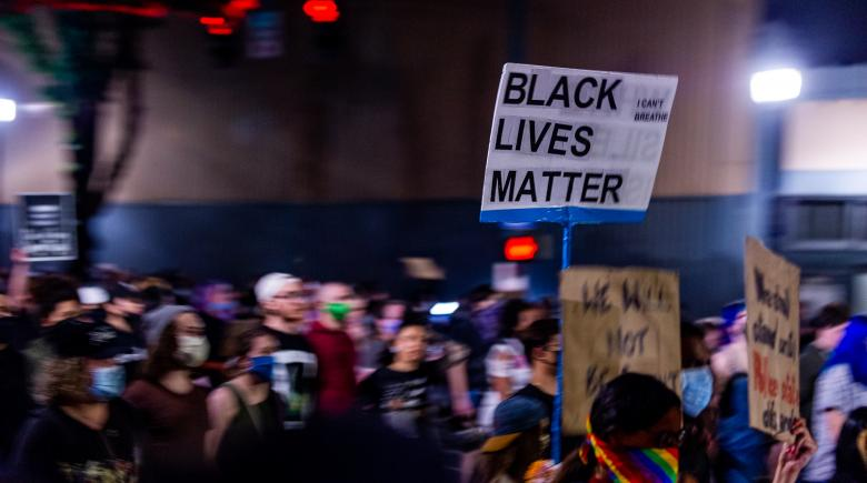 Crowds of protesters with Black Lives Matter signs