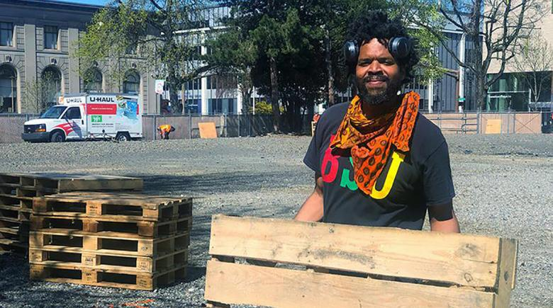 Nyanga Uuka helps build the camp in Old Town