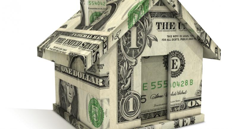 Illustration of house made of dollar bills