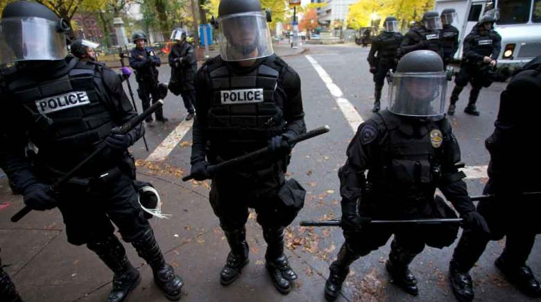 Riot police monitor Occupy Portland protesters in Portland on Nov. 13, 2011 REUTERS Steve Dipaola