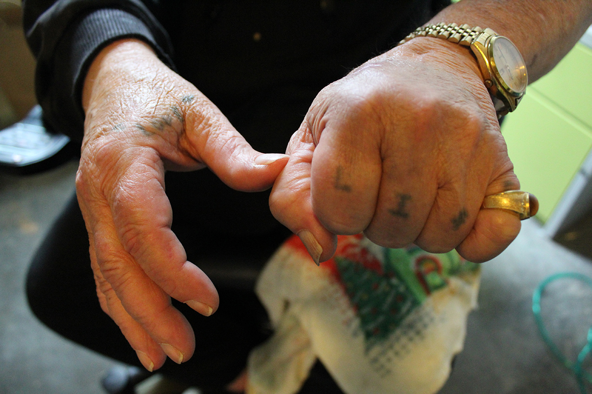 Billy Baggett shows his LIFE tattoo on his fingers