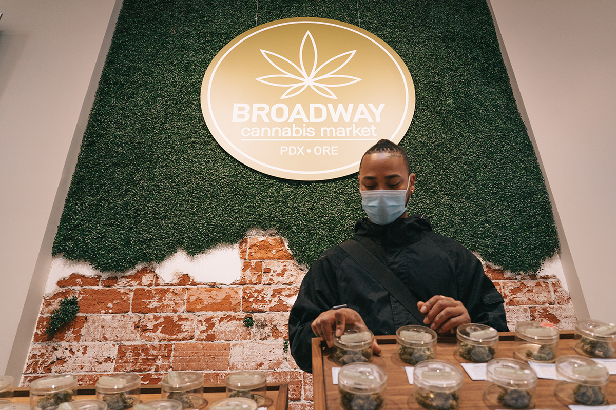 Kenneth Brown wears a mask at Broadway Cannabis Market